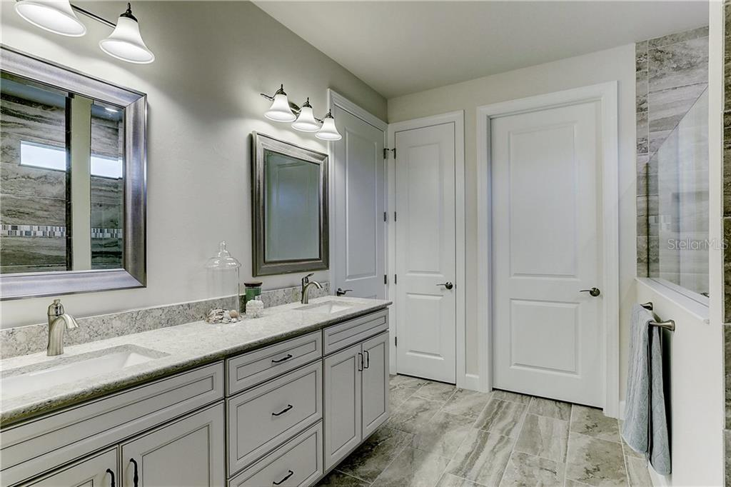 Master Bathroom with quartz countertops - Single Family Home for sale at 6859 Chester Trl, Lakewood Ranch, FL 34202 - MLS Number is A4458594