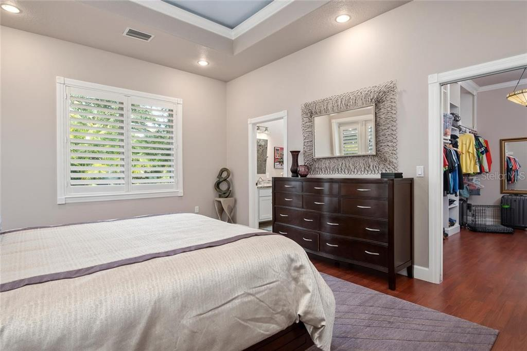 Master bedroom to master bath and large walk-in closet - Single Family Home for sale at 448 Baynard Dr, Venice, FL 34285 - MLS Number is A4459566