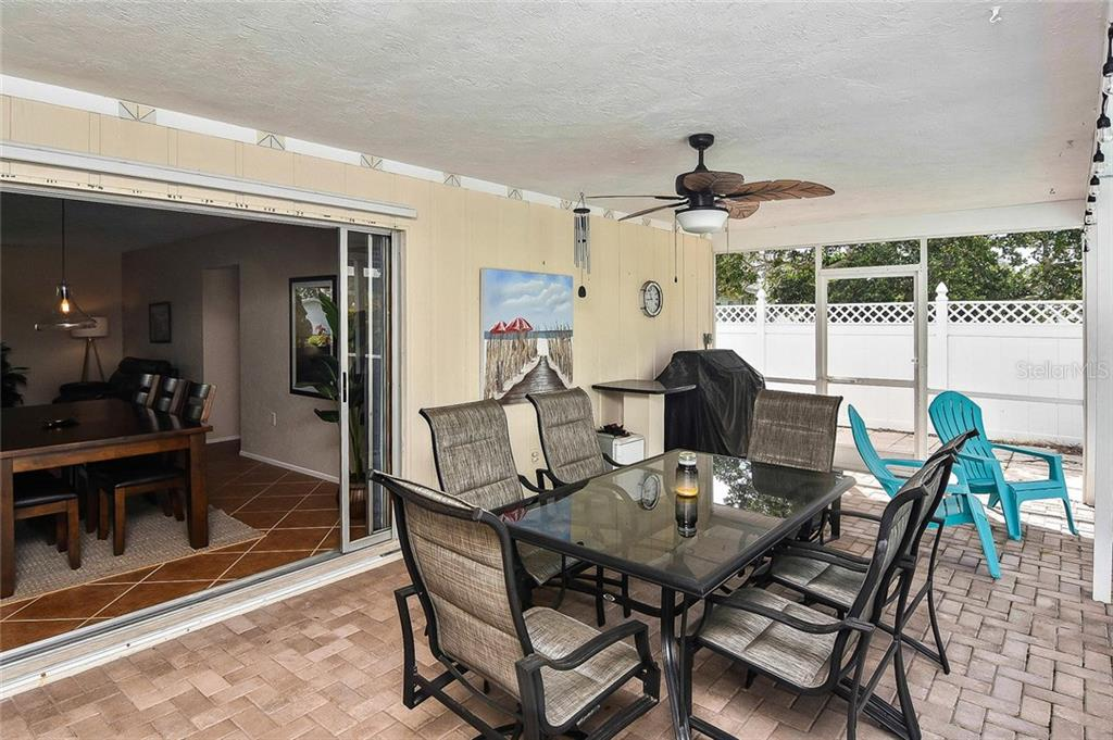 Lanai with sliders to dining room - Single Family Home for sale at 1758 Croton Dr, Venice, FL 34293 - MLS Number is A4459877