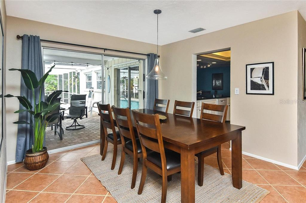 Dining room with sliders to lanai/pool - Single Family Home for sale at 1758 Croton Dr, Venice, FL 34293 - MLS Number is A4459877