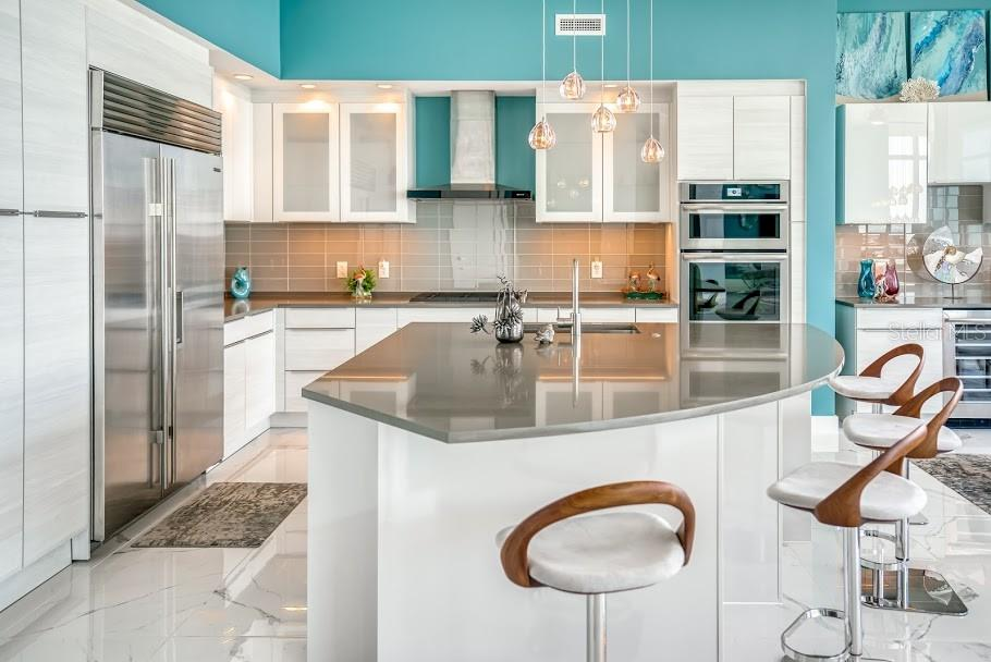 Expansive quartz island with a second built in wine fridge. - Condo for sale at 1155 N Gulfstream Ave #1909, Sarasota, FL 34236 - MLS Number is A4461040