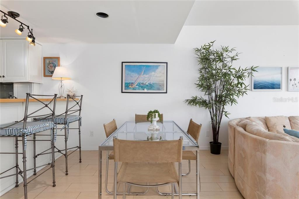 The dining area and the open kitchen bar. - Condo for sale at 490 N Shore Rd #7, Longboat Key, FL 34228 - MLS Number is A4461297