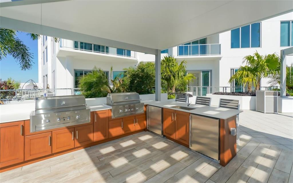 The Mark - Outdoor kitchen area. - Condo for sale at 111 S Pineapple Ave #1117 L-1, Sarasota, FL 34236 - MLS Number is A4461778