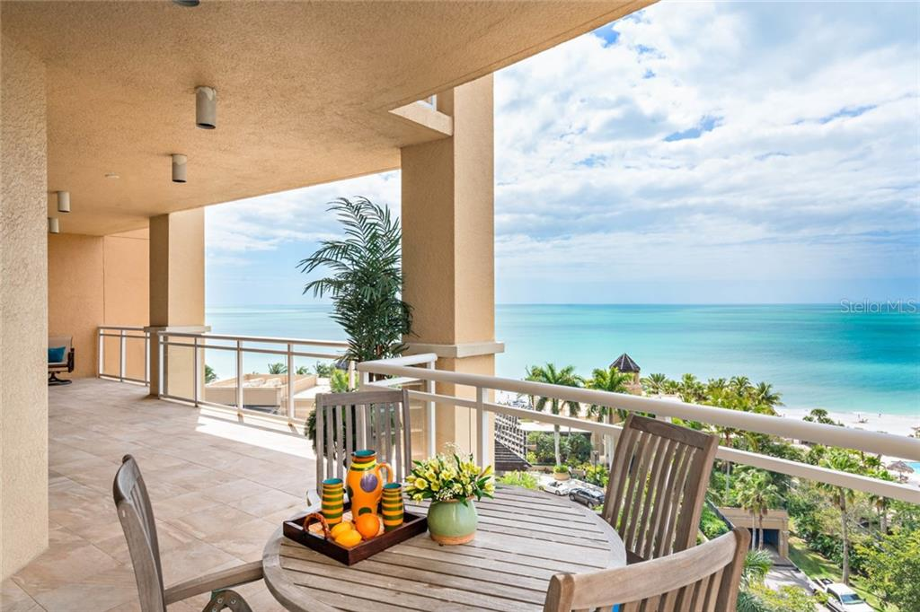 step out Terrace from kitchen area.. Water views from every angle, daily dolphin sightings! - Condo for sale at 1300 Benjamin Franklin Dr #805, Sarasota, FL 34236 - MLS Number is A4462621