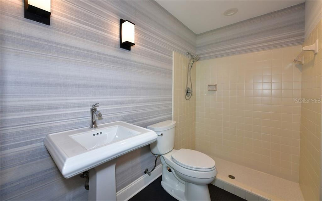 En-suite Bathroom in Office - Single Family Home for sale at 4700 Riverview Blvd, Bradenton, FL 34209 - MLS Number is A4462708