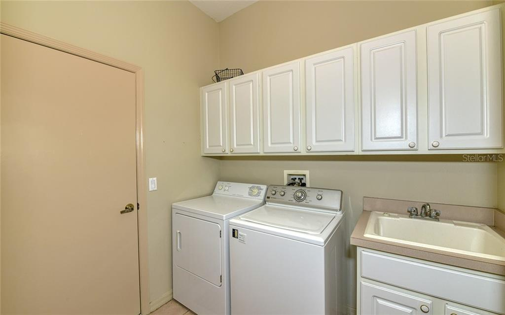 Laundry center with storage & tub off garage - Villa for sale at 4605 Samoset Dr, Sarasota, FL 34241 - MLS Number is A4463082
