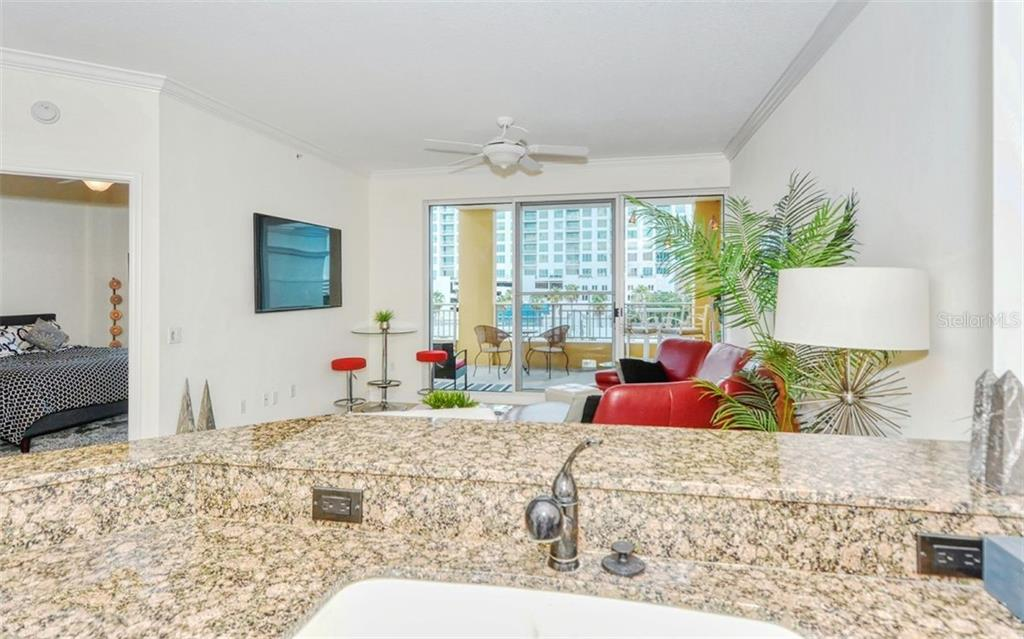 From the kitchen you can see the outdoors - Condo for sale at 100 Central Ave #A401, Sarasota, FL 34236 - MLS Number is A4463296