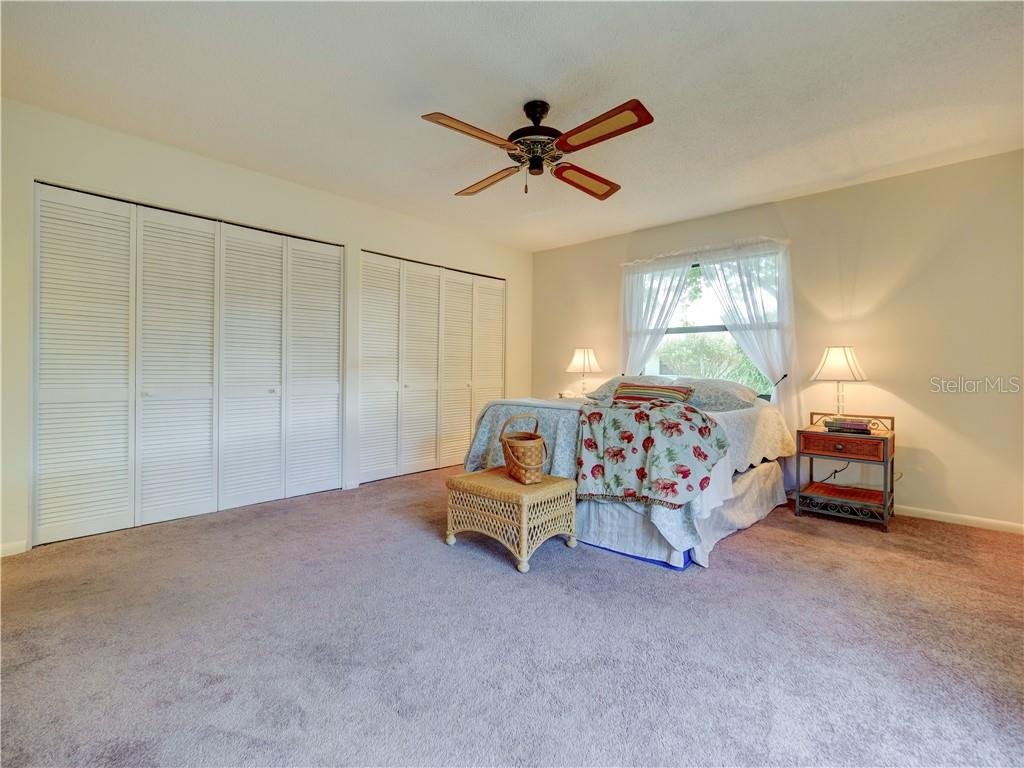 Master Bedroom with wall of storage and loads of natural light - Villa for sale at 4335 Rum Cay Cir, Sarasota, FL 34233 - MLS Number is A4463762