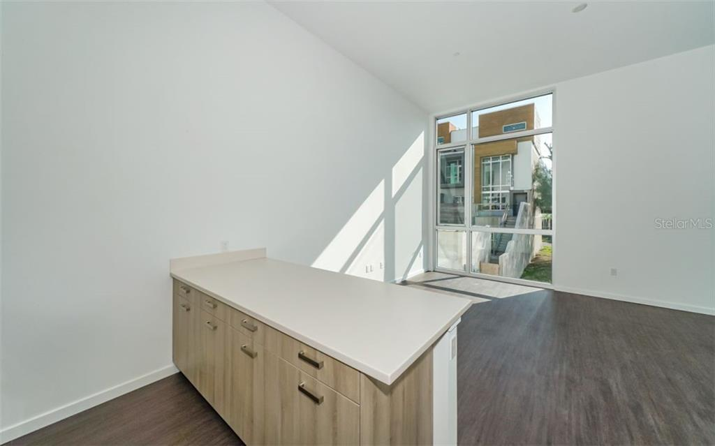 Solid surface counter tops, generous tasteful cabinet space. - Condo for sale at 1350 5th Street #104, Sarasota, FL 34236 - MLS Number is A4463799