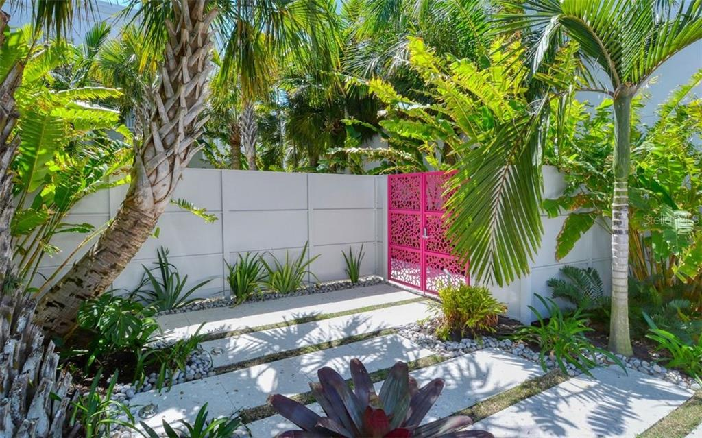 Ready for a private,, quite place to relax, yoga or meditate? The signature Zen garden awaits. - Condo for sale at 1350 5th Street #104, Sarasota, FL 34236 - MLS Number is A4463799