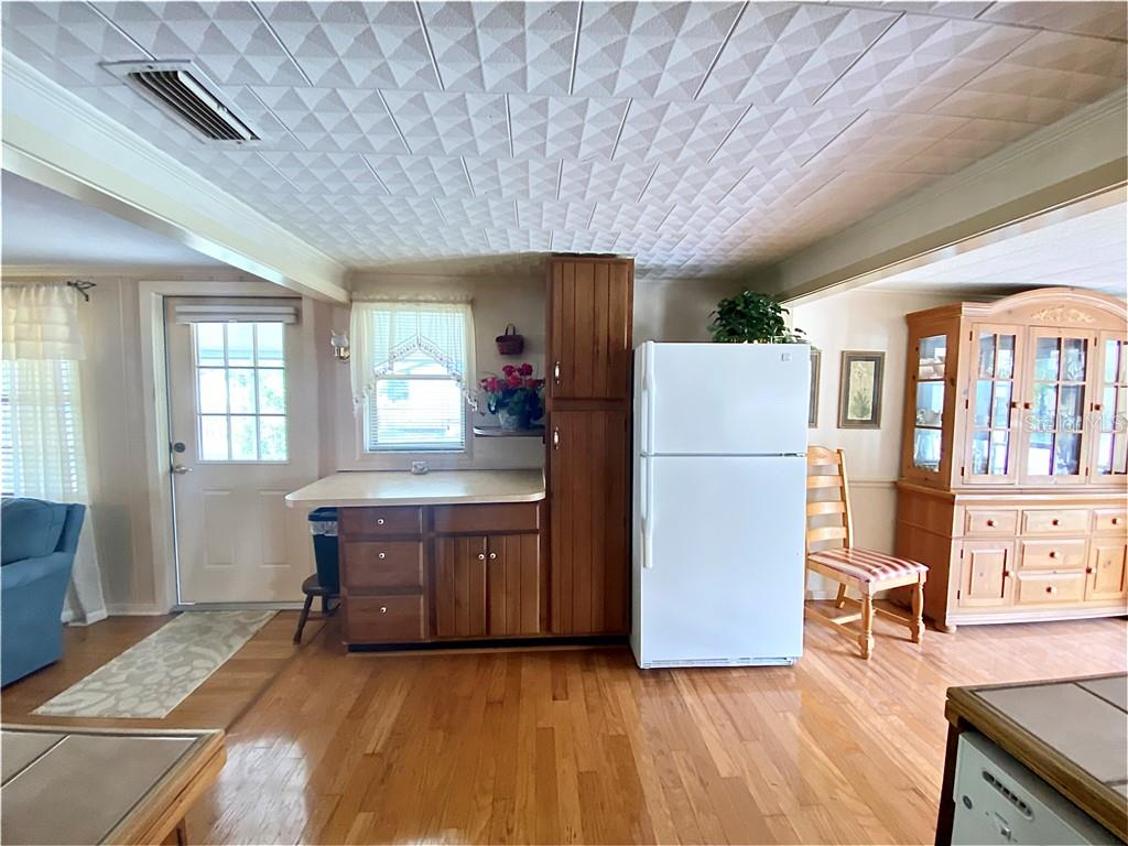 Kitchen, living room to the left, dining room to the right.  Door exits to the screened in lanai. - Single Family Home for sale at 4300 Eastern Pkwy, Sarasota, FL 34233 - MLS Number is A4464200
