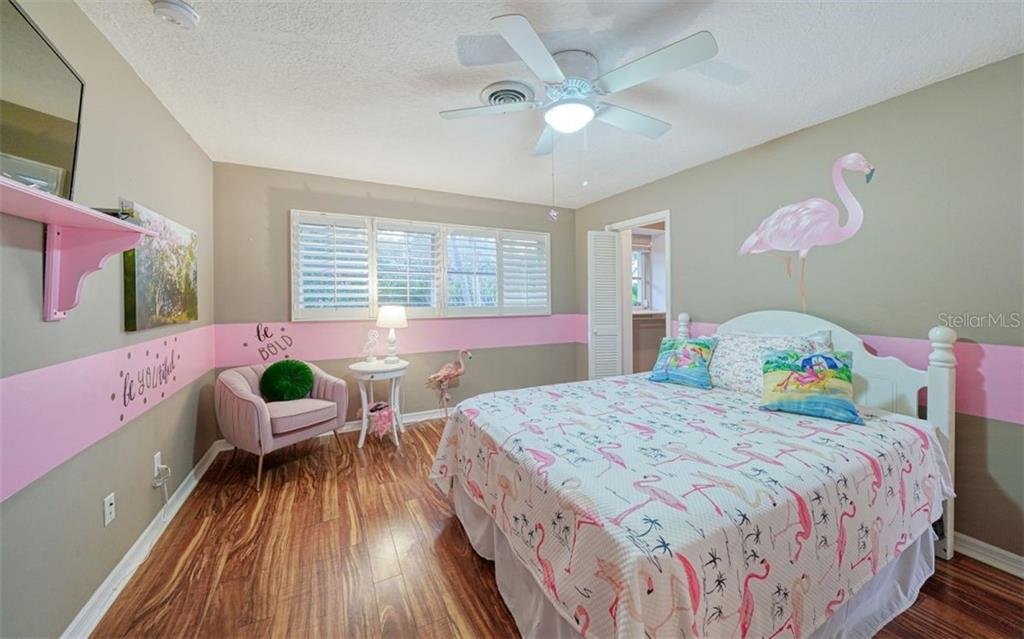 THE FLAMINGO ENSUITE , IT IS ALSO ADJACENT TO  THE POOL & COVERED TERRACE - Single Family Home for sale at 3 Winslow Pl, Longboat Key, FL 34228 - MLS Number is A4464990