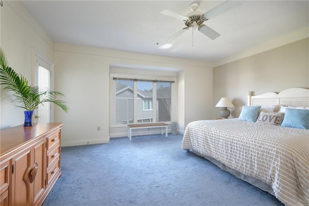 Enormous Master suite occupies the entire east side of the home. - Condo for sale at 515 Forest Way, Longboat Key, FL 34228 - MLS Number is A4465231