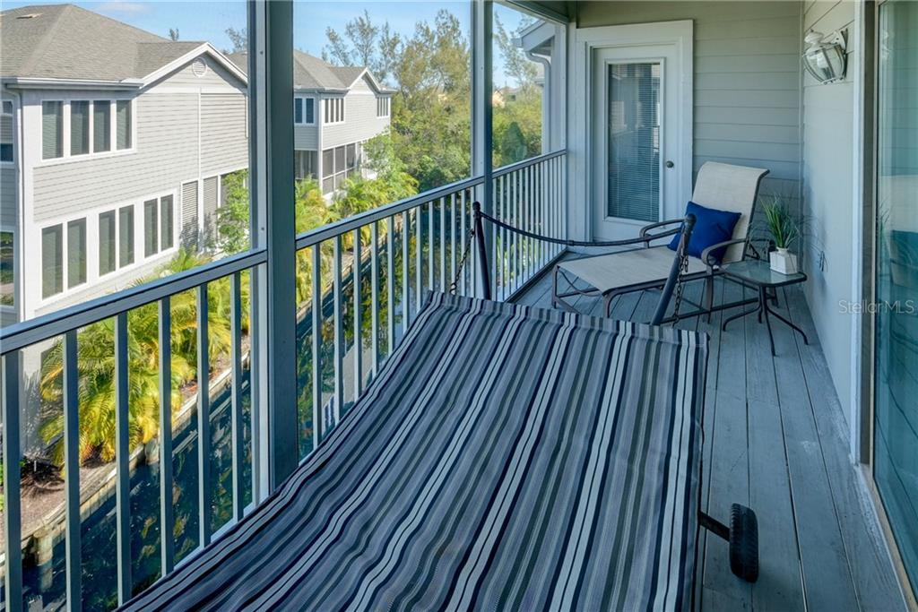 Hammock on second story screened deck also accessible from the Master. - Condo for sale at 515 Forest Way, Longboat Key, FL 34228 - MLS Number is A4465231