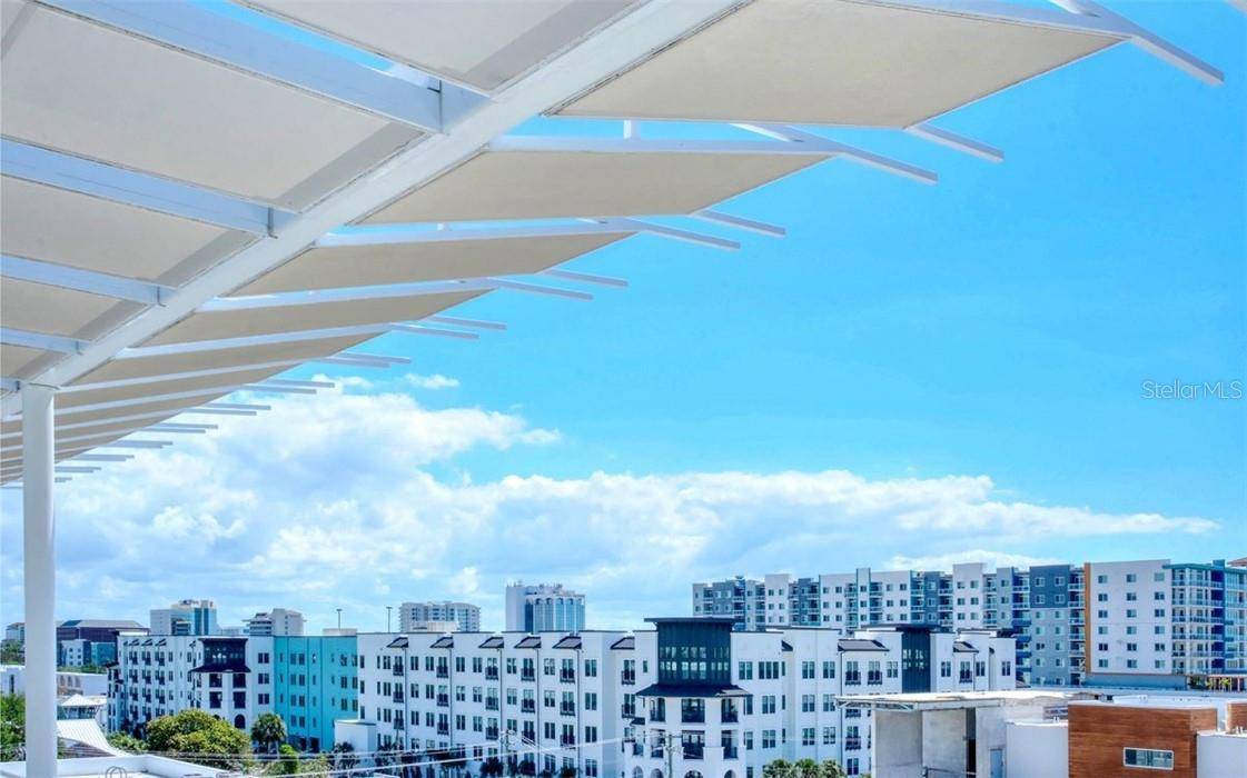 The roof top amenity allows you to enjoy the city skyline views to the east and observe the sunrise bounce along the diverse architecture. - Condo for sale at 1350 5th Street #301, Sarasota, FL 34236 - MLS Number is A4466172