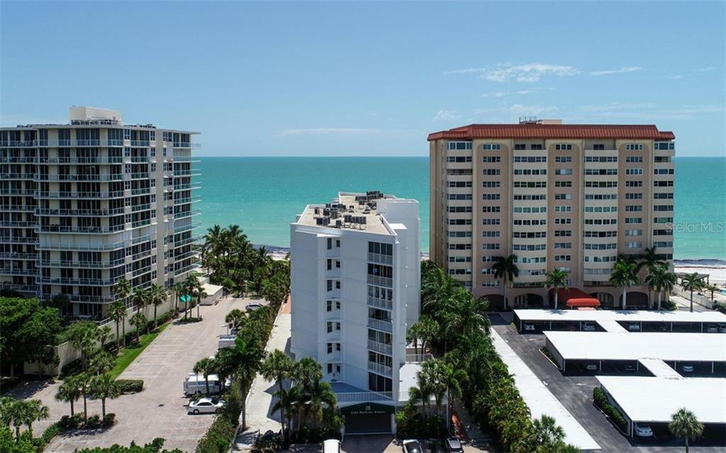 Lido Harbor Towers overlooking the turquoise water. - Condo for sale at 1770 Benjamin Franklin Dr #706, Sarasota, FL 34236 - MLS Number is A4469463