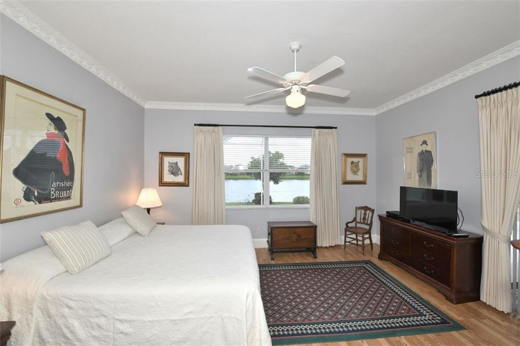 Set of sliders from the bedroom out to the lanai. - Villa for sale at 4590 Samoset Dr, Sarasota, FL 34241 - MLS Number is A4471881