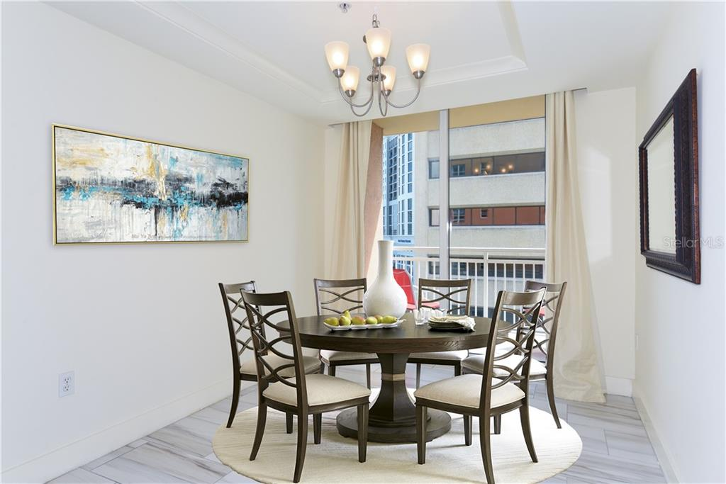 Dining room with its own terrace - Condo for sale at 1350 Main St #701, Sarasota, FL 34236 - MLS Number is A4472236