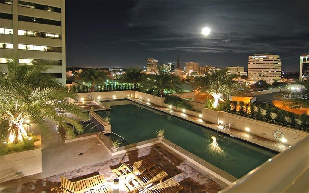 A nighttime view of the pool deck - Condo for sale at 1350 Main St #1001, Sarasota, FL 34236 - MLS Number is A4472708