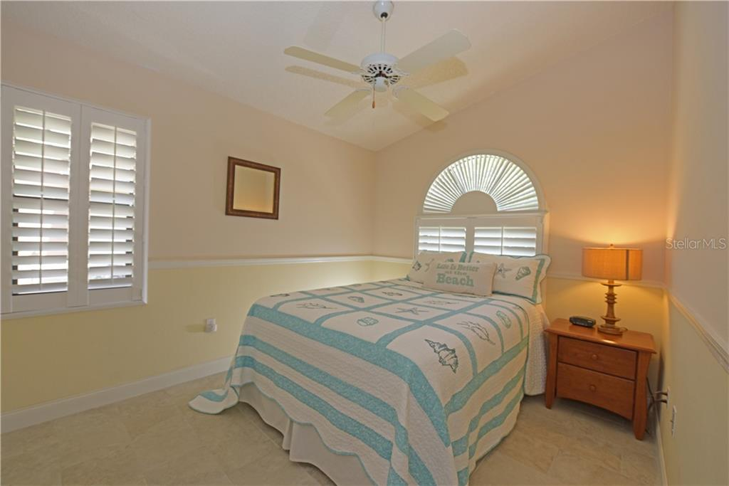 2nd bedroom Plantation shutters on windows - Single Family Home for sale at 3921 Warren St, Sarasota, FL 34233 - MLS Number is A4474011