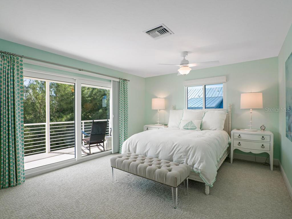 Guest bedroom with private balcony - Single Family Home for sale at 500 Beach Rd #1, Sarasota, FL 34242 - MLS Number is A4474527