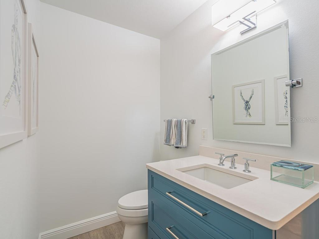 1st floor half bathroom - Single Family Home for sale at 500 Beach Rd #1, Sarasota, FL 34242 - MLS Number is A4474527