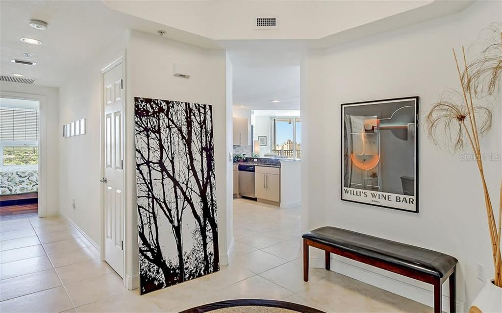 A welcoming foyer - Condo for sale at 1771 Ringling Blvd #1110, Sarasota, FL 34236 - MLS Number is A4474683