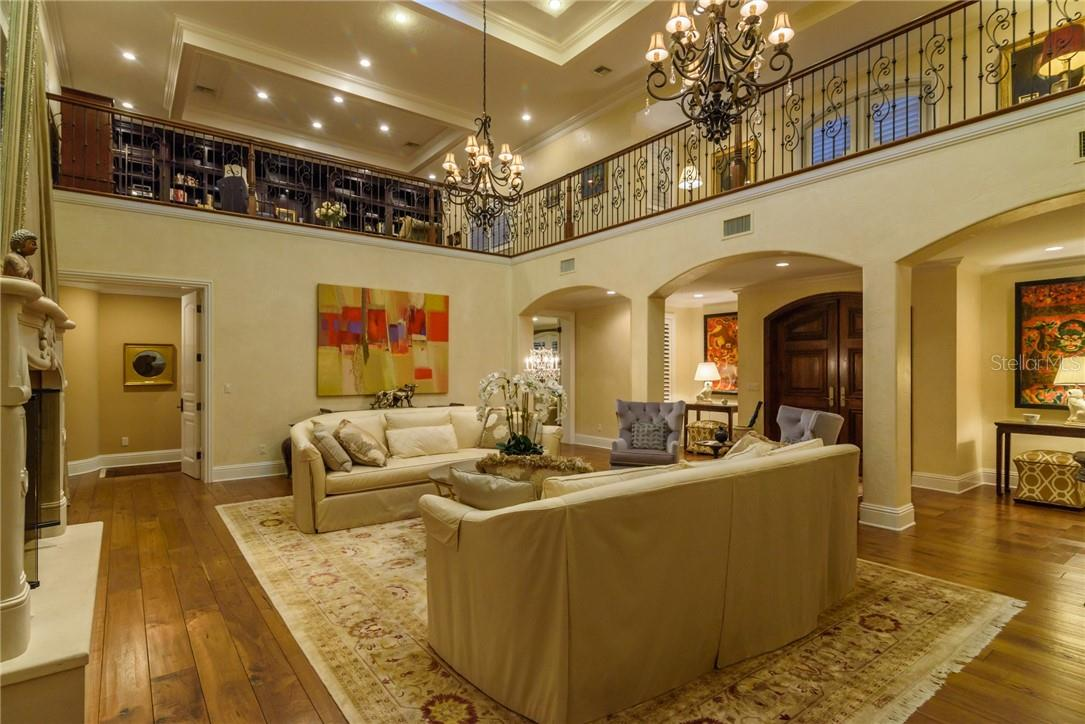Grand foyer blossoms into a two story living room with crackling fireplace beckoning, and a winding staircase leads you to the spacious 2nd floor library and two bedrooms ensuite. - Single Family Home for sale at 1807 Oleander St, Sarasota, FL 34239 - MLS Number is A4475067