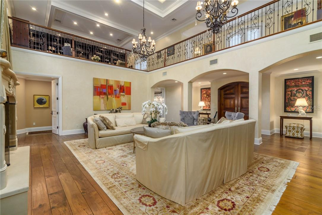 Dramatic grand foyer plus two story living room with walnut plank flooring and plenty of coffered ceilings and crown mouldings throughout the home. - Single Family Home for sale at 1807 Oleander St, Sarasota, FL 34239 - MLS Number is A4475067
