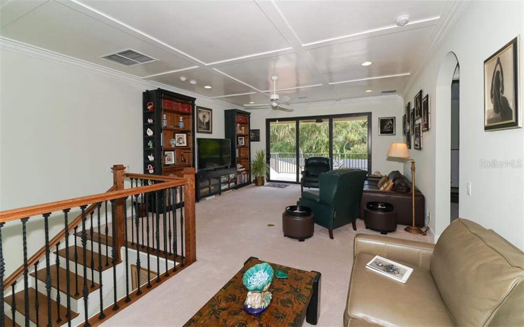 second floor family room with balcony overlooking the pool, spa, fire pit and 9th frairway! - Single Family Home for sale at 3538 Trebor Ln, Sarasota, FL 34235 - MLS Number is A4475545