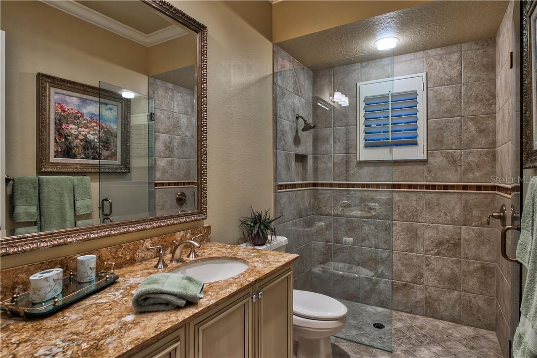 Guest Apartment Full Bathroom - Single Family Home for sale at 8499 Lindrick Ln, Bradenton, FL 34202 - MLS Number is A4475594