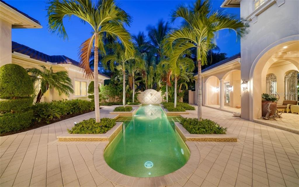 Courtyard 45' salt water heated lap pool - Single Family Home for sale at 35 Lighthouse Point Dr, Longboat Key, FL 34228 - MLS Number is A4477572
