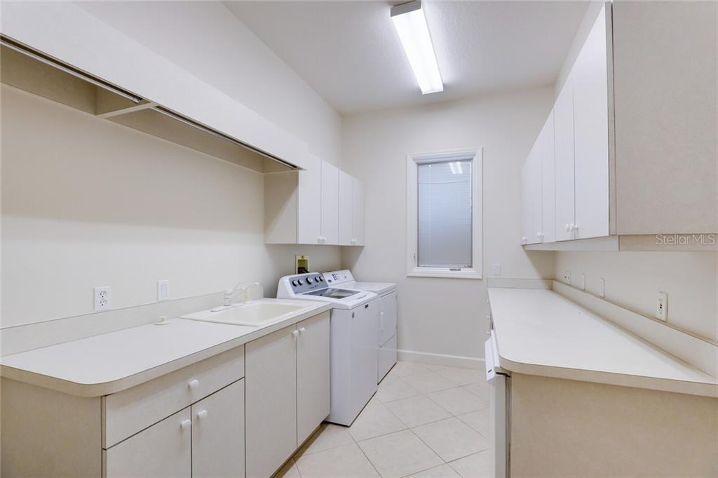 Space, space and more space in this laundry room. Excellent for crafting, storage, or the hobbyist. Located immediately off the kitchen.  Across the hall is a large walk-in pantry. - Single Family Home for sale at 9618 53rd Dr E, Bradenton, FL 34211 - MLS Number is A4477826