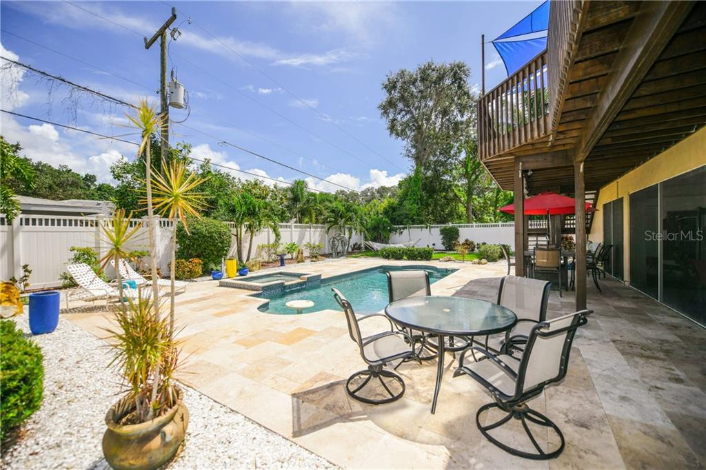 Spa/pool with travertine patio. - Single Family Home for sale at 7303 Westmoreland Dr, Sarasota, FL 34243 - MLS Number is A4478376