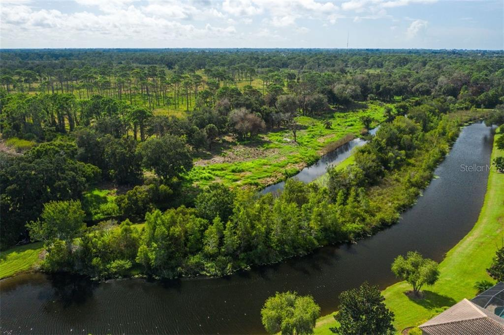 Aerial view to State Park - Single Family Home for sale at 684 Crane Prairie Way, Osprey, FL 34229 - MLS Number is A4478575