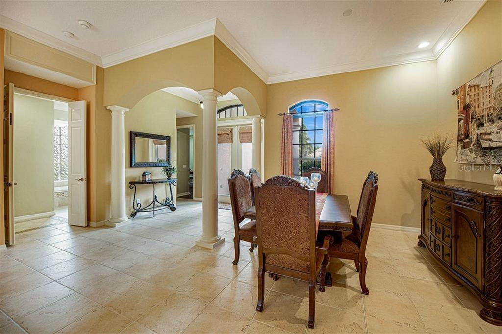 Formal Dining room, high ceilings, loaded with crown and design accents - Single Family Home for sale at 684 Crane Prairie Way, Osprey, FL 34229 - MLS Number is A4478575