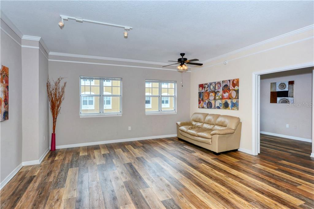 Great room with laminate flooring. - Condo for sale at 1064 N Tamiami Trl #1522, Sarasota, FL 34236 - MLS Number is A4479270