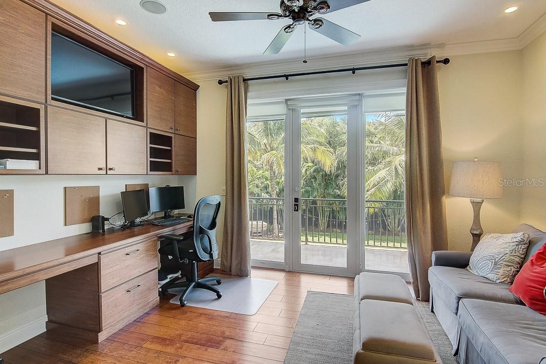 Office with custom built in desk...plenty of storage and balcony - Single Family Home for sale at 1839 Buccaneer Ct, Sarasota, FL 34231 - MLS Number is A4479580
