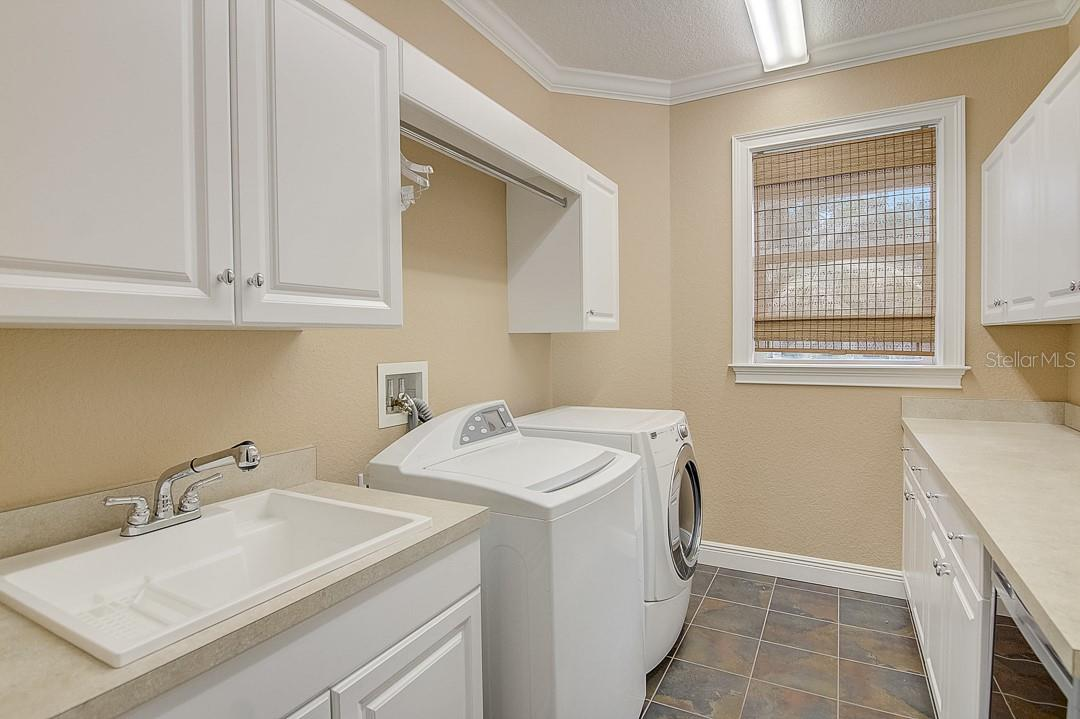 Upstairs laundry with built in sink and plenty of storage - Single Family Home for sale at 1839 Buccaneer Ct, Sarasota, FL 34231 - MLS Number is A4479580