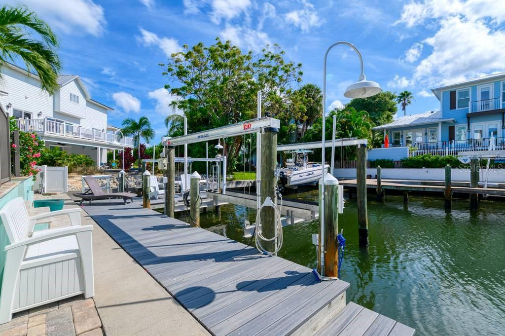 Dock with 9500lb boat lift. - Single Family Home for sale at 718 Key Royale Dr, Holmes Beach, FL 34217 - MLS Number is A4480381