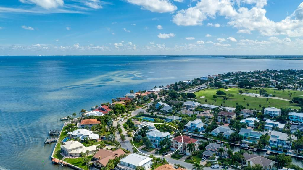 Aerial view of Key Royale and Tampa Bay. - Single Family Home for sale at 718 Key Royale Dr, Holmes Beach, FL 34217 - MLS Number is A4480381