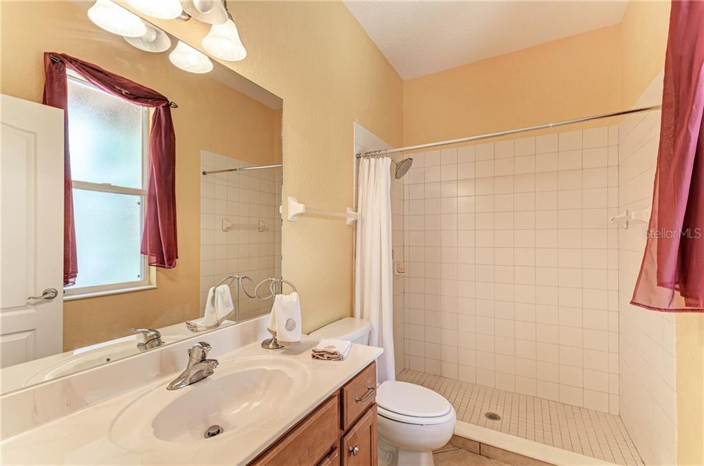 2nd bathroom - Single Family Home for sale at 7118 68th Dr E, Bradenton, FL 34203 - MLS Number is A4480398