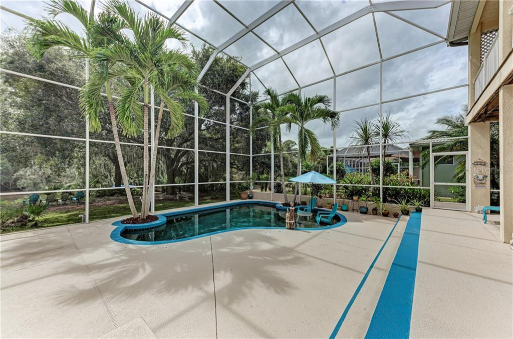 Tropical pool setting - Single Family Home for sale at 7118 68th Dr E, Bradenton, FL 34203 - MLS Number is A4480398