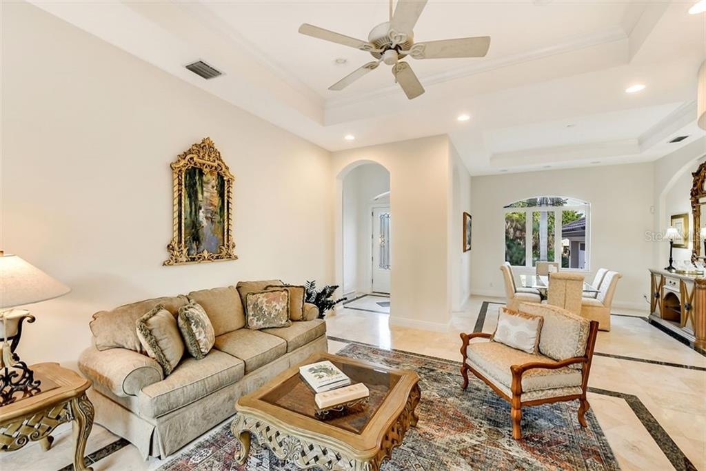 Formal Living & dining rooms, great entertaining space - Single Family Home for sale at 501 Cutter Ln, Longboat Key, FL 34228 - MLS Number is A4480484