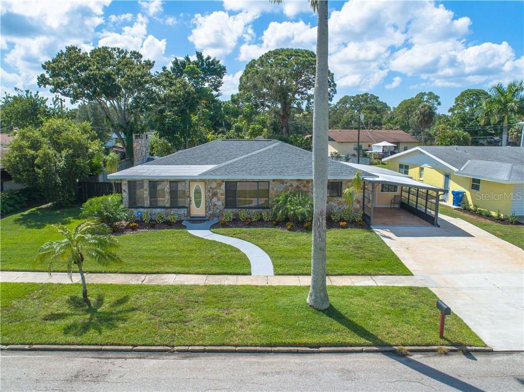 Front aerial view of home.  New roof in 2018! - Single Family Home for sale at 2408 Riverside Dr E, Bradenton, FL 34208 - MLS Number is A4480609