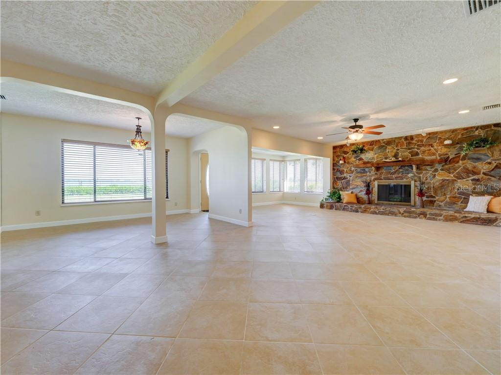 Expansive open floorplan living room with open dining room.  Views of the Manatee River from every window. - Single Family Home for sale at 2408 Riverside Dr E, Bradenton, FL 34208 - MLS Number is A4480609