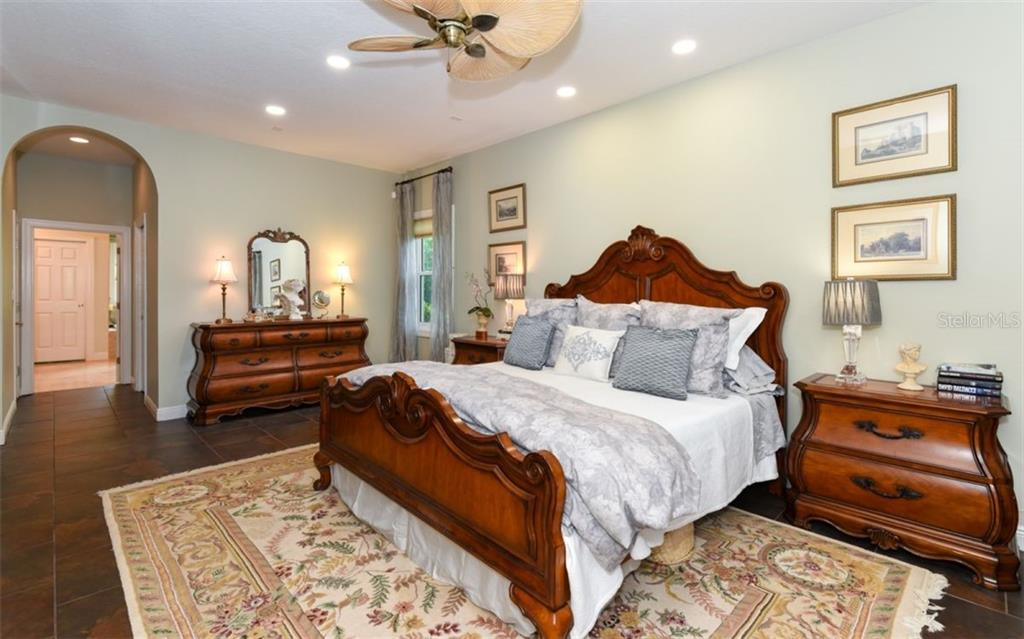 In the master suite you will find a large custom walk in closet, large linen closet and private ensuite. - Single Family Home for sale at 1603 Landfall Dr, Nokomis, FL 34275 - MLS Number is A4480987