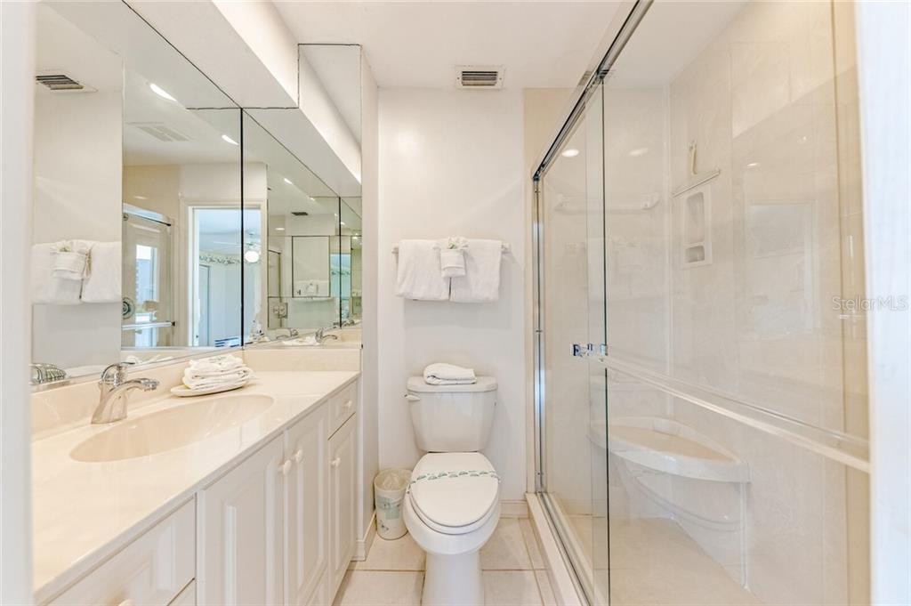 Master bath with walk-in shower - Condo for sale at 5830 Midnight Pass Rd #303, Sarasota, FL 34242 - MLS Number is A4481917