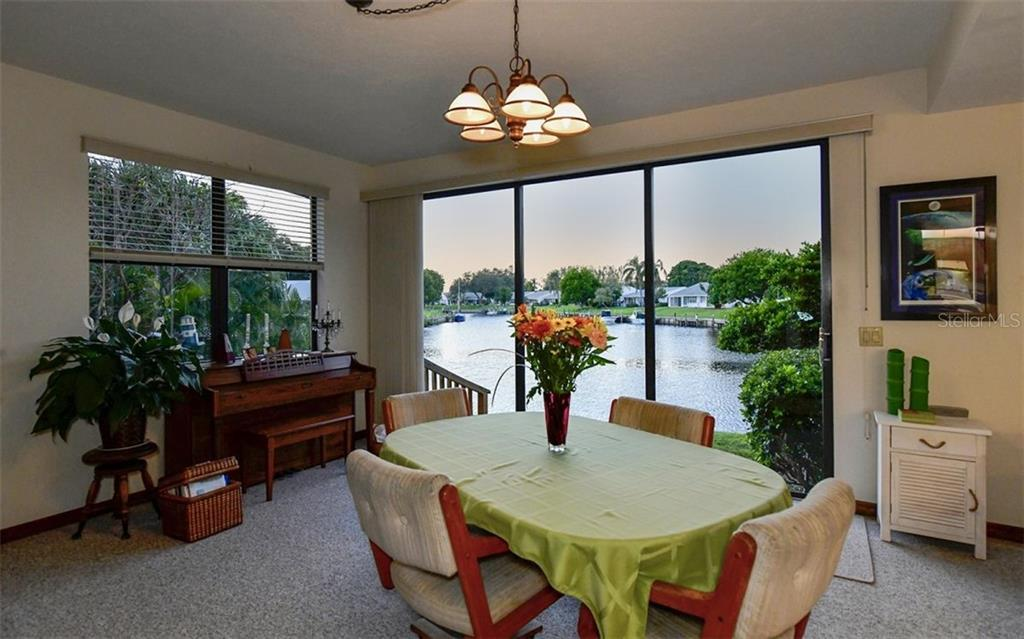 Dining room table is positioned here to enjoy the open water view through most westerly sliders - Single Family Home for sale at 9219 Bimini Dr, Bradenton, FL 34210 - MLS Number is A4483083
