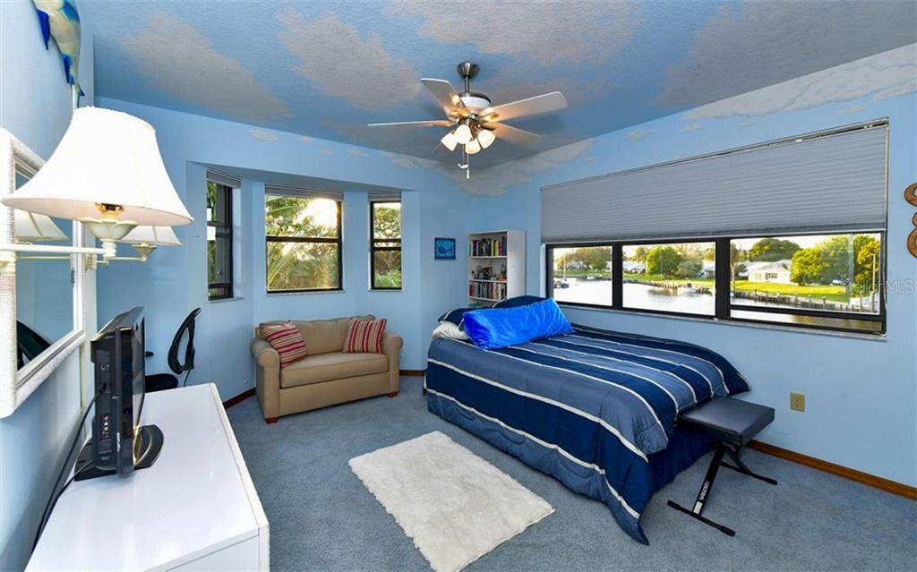 Bedroom 4 upstairs doubles as a guest suite-complete with a full bath - Single Family Home for sale at 9219 Bimini Dr, Bradenton, FL 34210 - MLS Number is A4483083